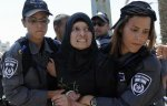 A Palestinian protestor is detained by Israeli police during a demonstration against Israeli government plans to relocate Palestnian Bedouins in the Naqab desert, on 15 July 2013 in the southern city of Bi'r As Sabi'. (© AFP , Davif Buimovitch)
