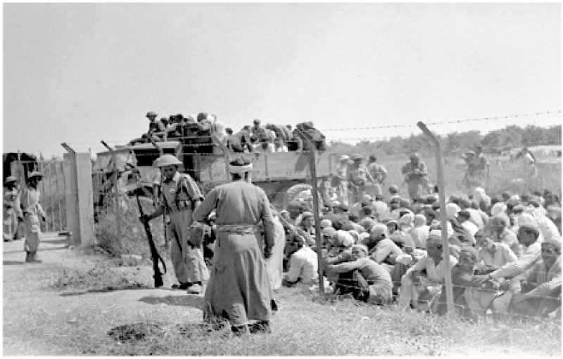 Palmach Troups gathering Palestinians from al-Ramel to be ready for displacement, 6 july 1948. (©Ariella Azoulay)