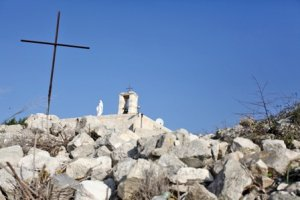 Demolished houses and church in Iqrit, 2012 (© RW/BADIL)