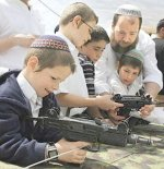 Armed settlers training at an early age in Hebron, West Bank. 18 November 2008. (photo: ccun.org)