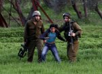 Israeli soldiers arrest a Palestinian during clashes near Huwwara checkpoint near Nablus, West Bank. (© EPA-ALAA, 25 February 2013 BADARNEH)