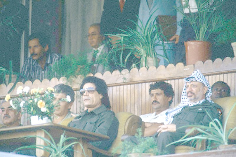 Al-Qaddafi and Arafat at the 19th Anniversary of the Libyan Revolution, August 1988. (Corbis Images/Bernard Bisson)