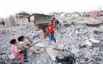 Palestinian children play on the ruins of their homes in Jabalya, Gaza, destroyed by the Israeli war in 2008-2009 © AFP